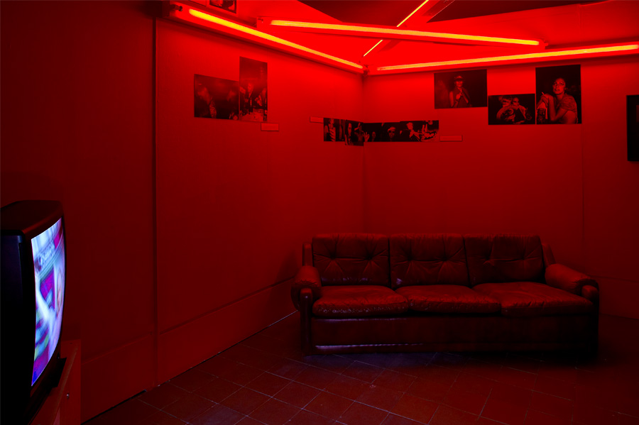 Backroom with Dan Flavin Red Neon Triangle Sculpture